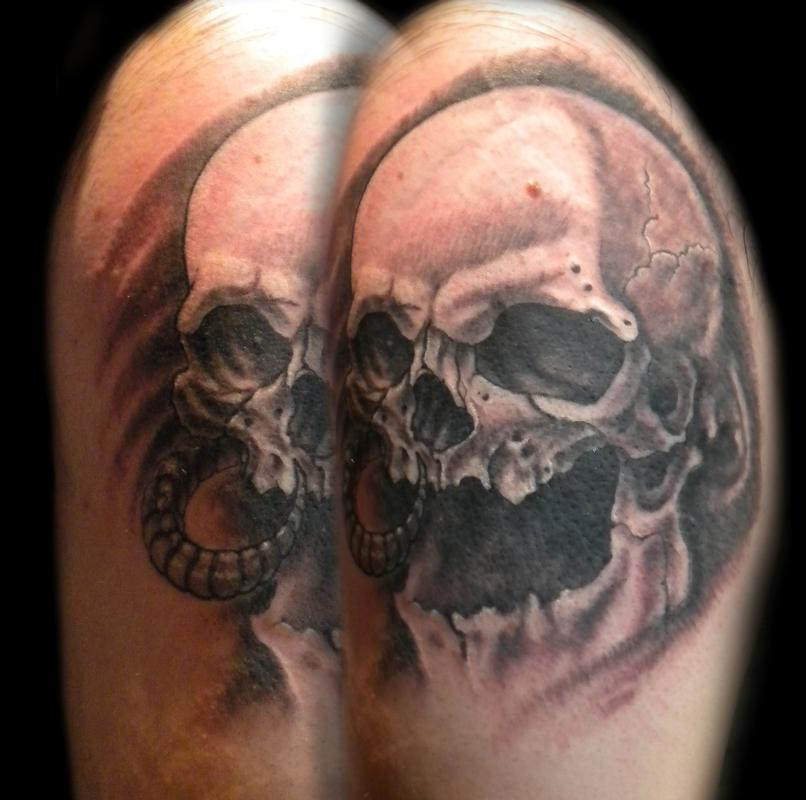 Ring and earring skull tattoo