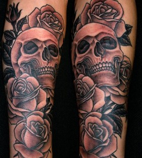 Roses and grey skull tattoo