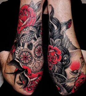 Roses and skulls men's arm tattoo