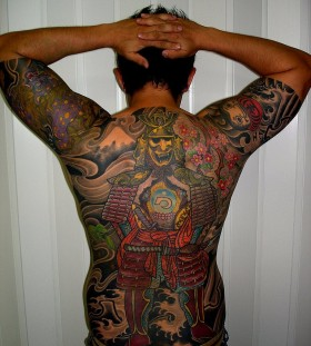Samurai style men's back tattoo