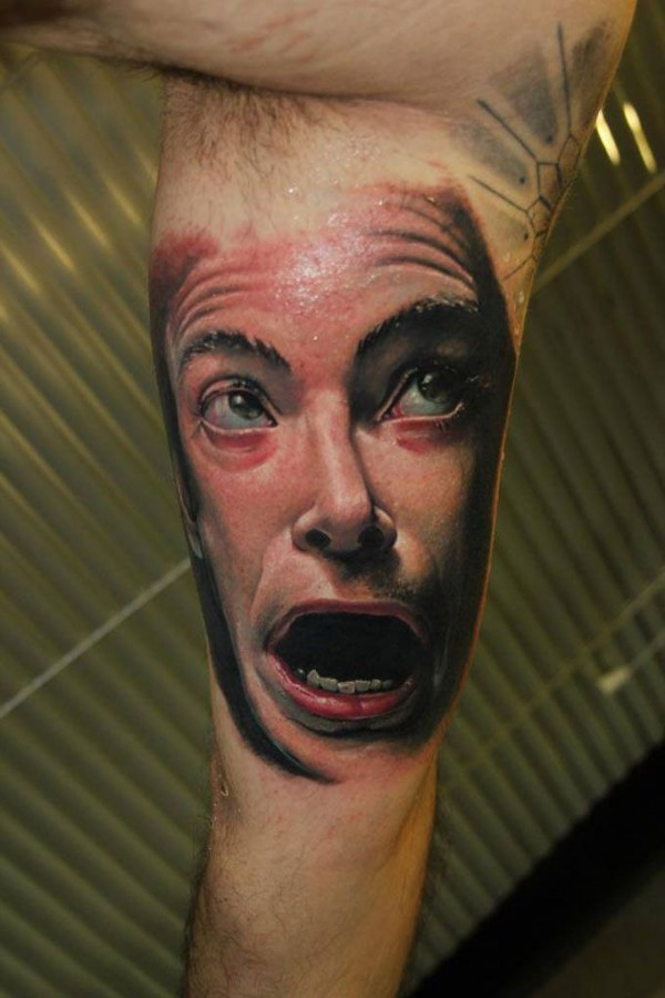 Scared face tattoo by Victor Chil