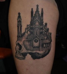 Scary skull castle tattoo