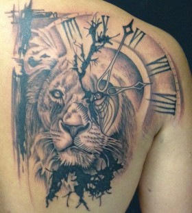 Shoulder clock and lion tattoo