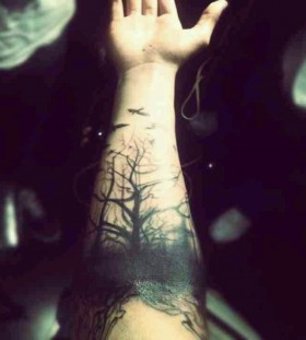Simple arm's black tree tattoo