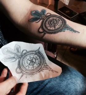 Simple arm's compass tattoo