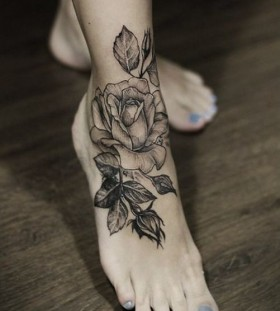 Simple leg's rose tattoo