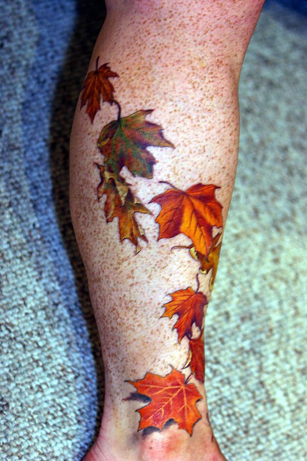 Simple looking autumn colorful tattoo