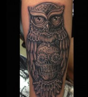 Simple owl and skull tattoo