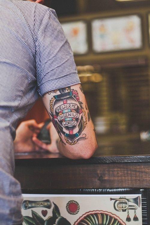 Simple quotes men's arm tattoo