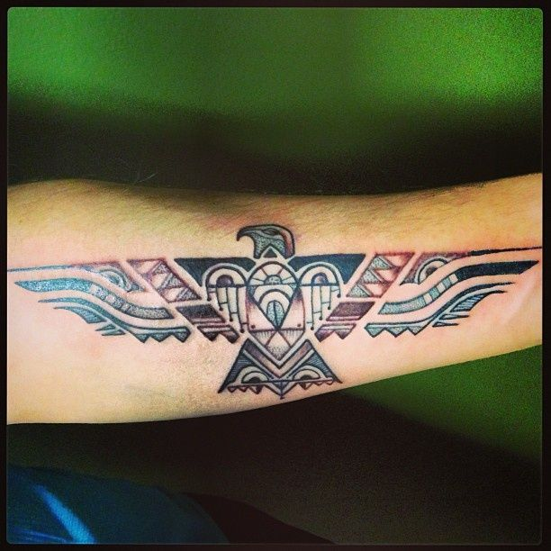 Simple red and black eagle tattoo