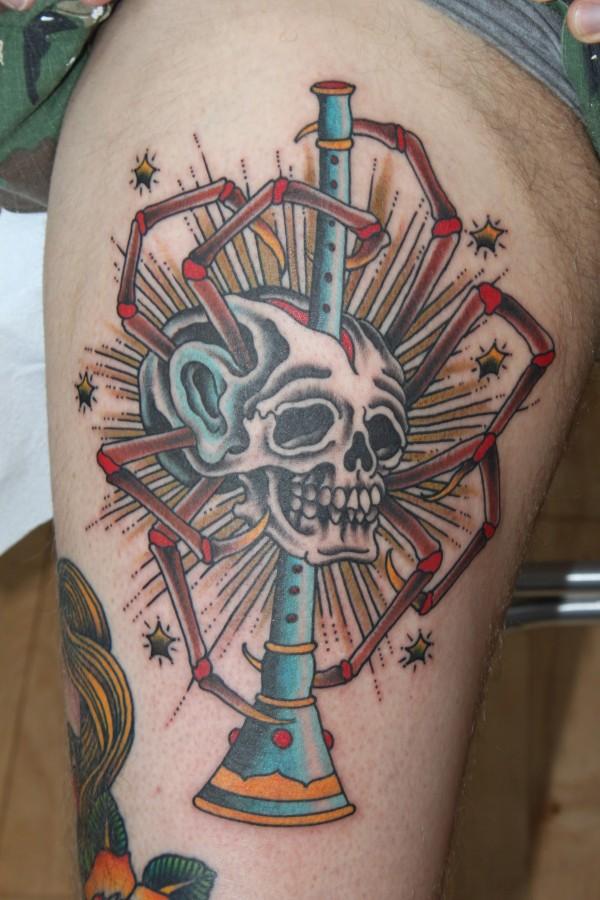 Simple skull clarinet tattoo