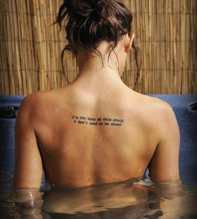 Simple women's back quote tattoo