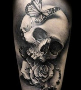 Skull and butterflies men's arm tattoo