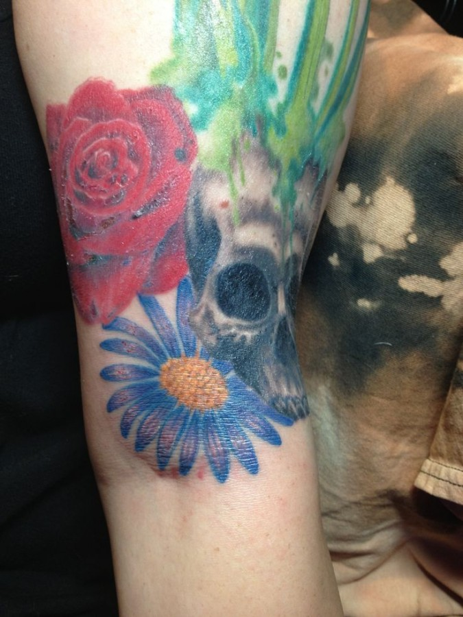 Skull, red with blue cornflower tattoo