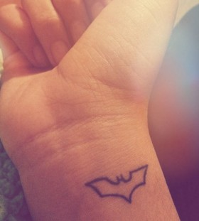Small adorable batman tattoo