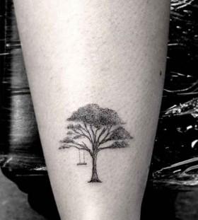 Small black tree tattoo