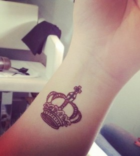 Small cute king style tattoo on arm