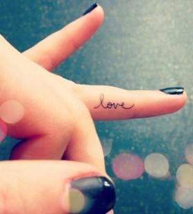 Small finger love tattoo