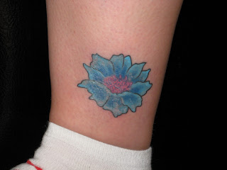 Small leg cornflower tattoo