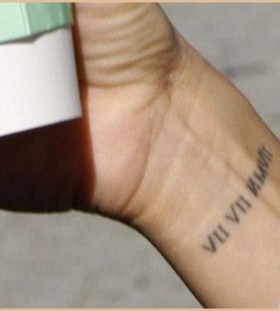 Small roman numerals date tattoo on arm