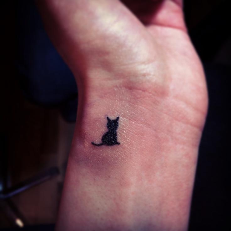 Small wrist cat tattoo