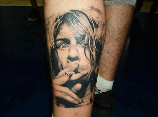 Smoking face nirvana tattoo