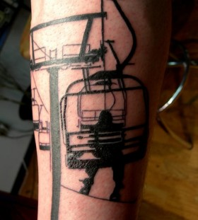 Snowboarder lift skiing tattoo