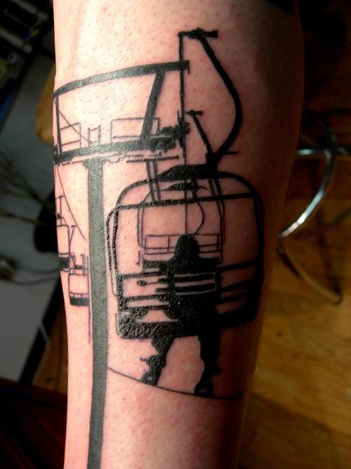 Snowboarder lift skiing tattoo