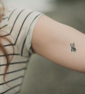 So cute black girl's bee tattoo on arm