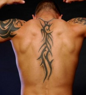 Strong ornamentally men's back tattoo