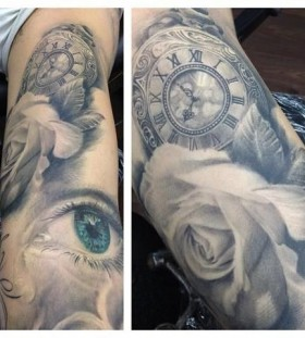 Stunning blue eye's and watch with rose tattoo