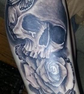 Stunning butterfly, cross and skull tattoo