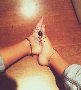 Sun and moon foot tattoo