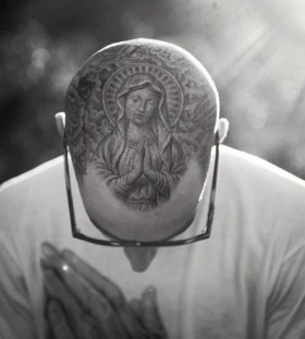 Travis Barker's black tattoo on head