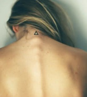 Triangle style tattoo on neck