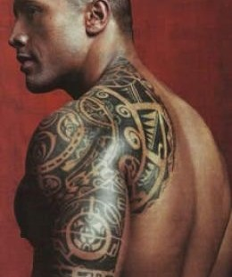 Tribal style men's shoulder tattoo