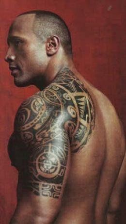 Tribal style men's shoulder tattoo