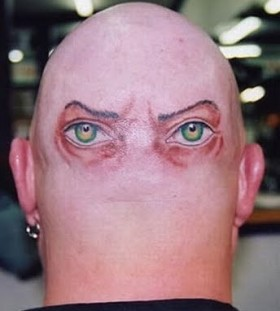 Two simple eyes tattoo on head