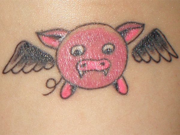 Vampire pink pig tattoo
