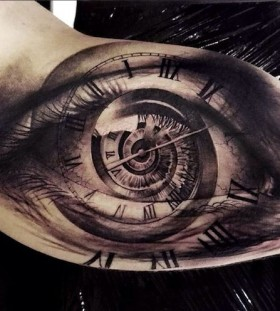 Watch and black eye tattoo