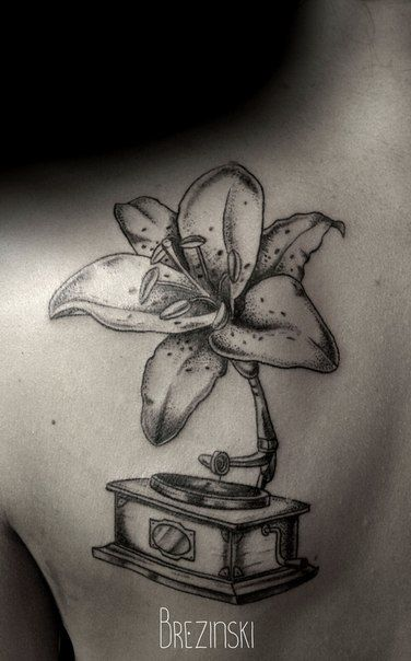 White flower Ilya Brezinski tattoo