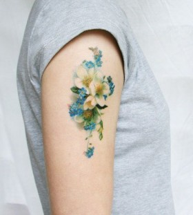 White vintage flower's blue tattoo