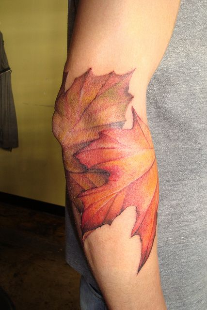 Women's arm's autumn colorful tattoo