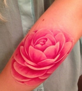 Women's arm's pink rose tattoo
