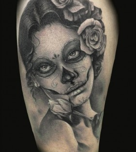 Women's face and skull tattoo