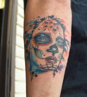 Women's face watercolor skull tattoo