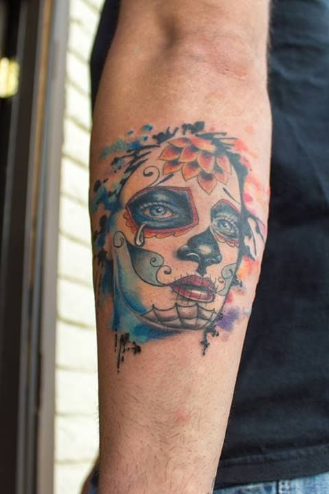 Women's face watercolor skull tattoo