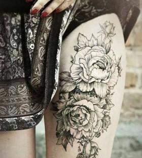 Women's leg flower tattoo