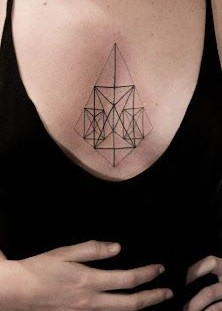 Women's pyramid geometric style tattoo