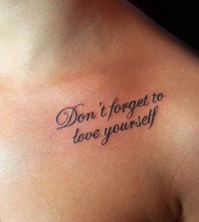 Women's shoulder quote tattoo